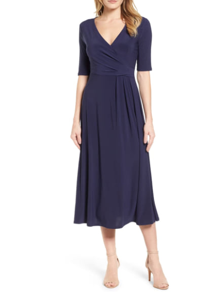 Woman wearing the Laura Faux Wrap Midi Dress from Nordstrom