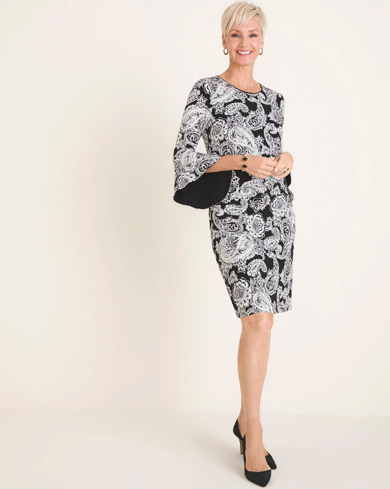 Woman wearing the Black and White Paisley Bell-Sleeve Dress from Chico's