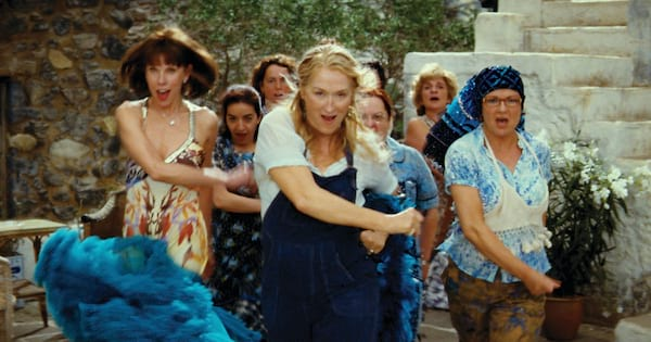 Donna, Tanya, and Rosie all dancing together in a scene from 'Mamma Mia!'
