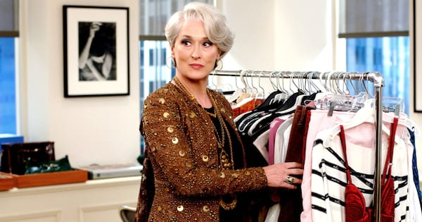 Meryl Streep going through a bunch of clothes on a rack in 'The Devil Wears Prada'