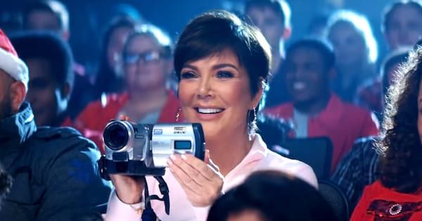 Kris Jenner holding a camera and recording Ariana Grande in the \Thank U, Next\ music video