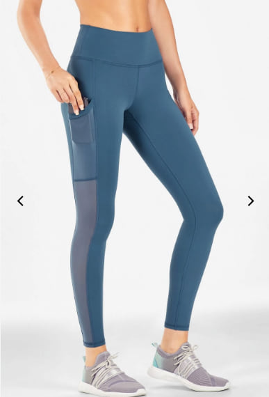 Woman wearing the Mila High-Waisted Pocket Legging from Fabletics