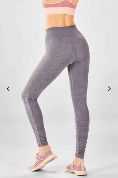 Woman wearing the High-Waisted Seamless Ruched Legging from Fabletics