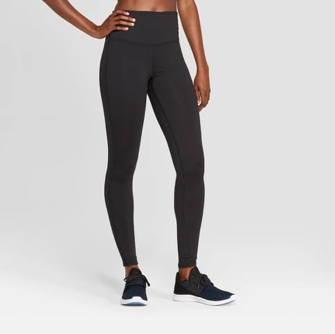 Woman wearing the Champion Everyday High-Waisted Leggings from Target