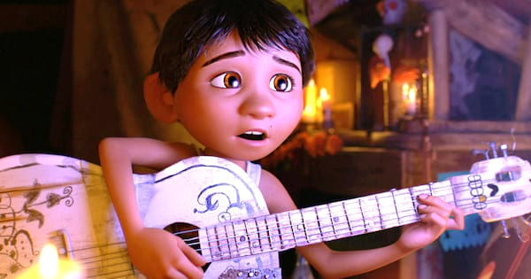 Miquel strumming the guitar and singing in 'Coco'