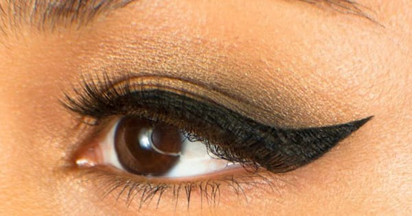 Close up of a woman's eye with winged eyeliner created with the Cleopatra Cat Eye Stamp from Lyda Beauty