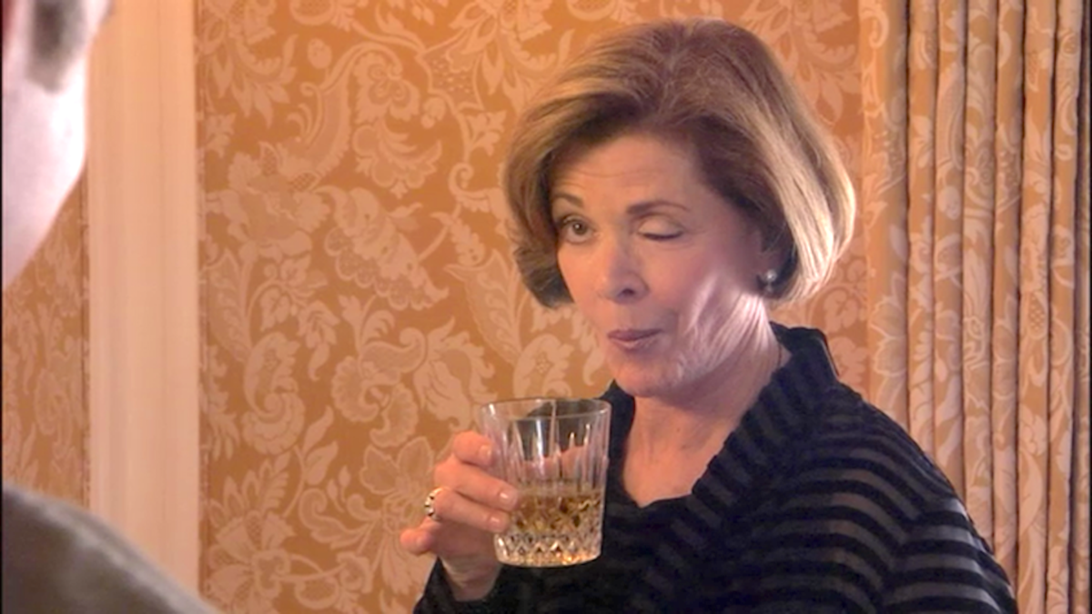 Lucille Bluth drinking a cocktail and winking on Fox show, arrested development