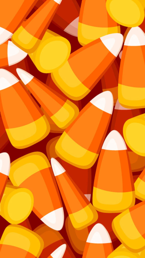 Seamless background with candy corn. Vector illustration. - Vector