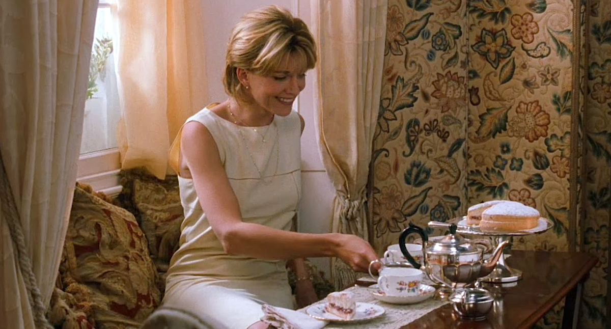 Natasha Richardson as Elizabeth James in Parent Trap, wearing a white dress smiling and drinking tea