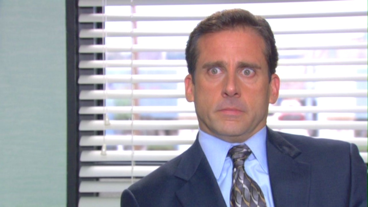 Michael Scott looking shocked with his eyes wide in a scene from The Office