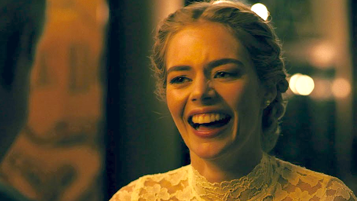 Samara Weaving as Grace in 'Ready or Not' laughing in a wedding dress with a braid in her hair