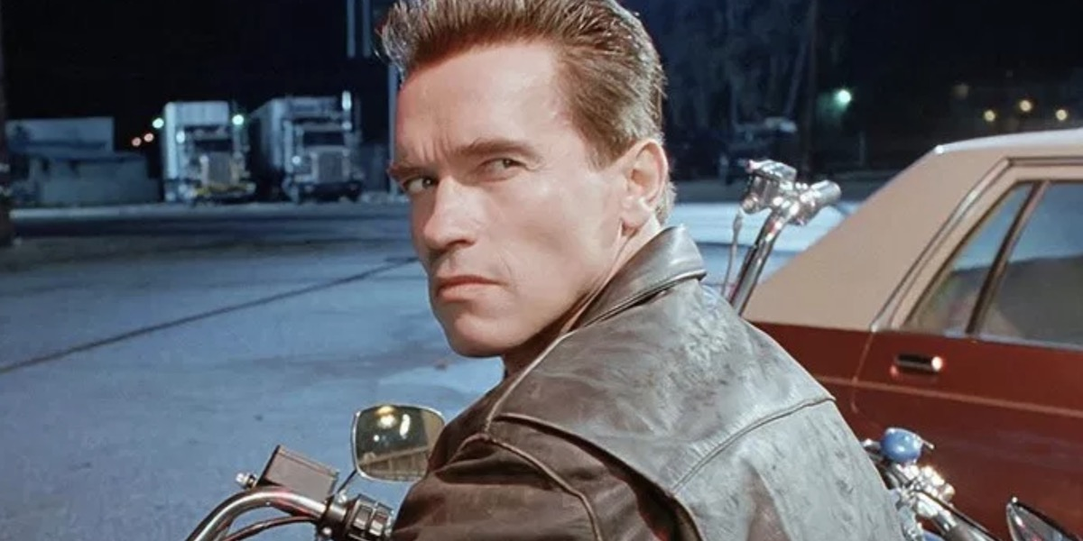 Arnold Schwarzenegger as The Terminator looking over his shoulder on a motorcycle