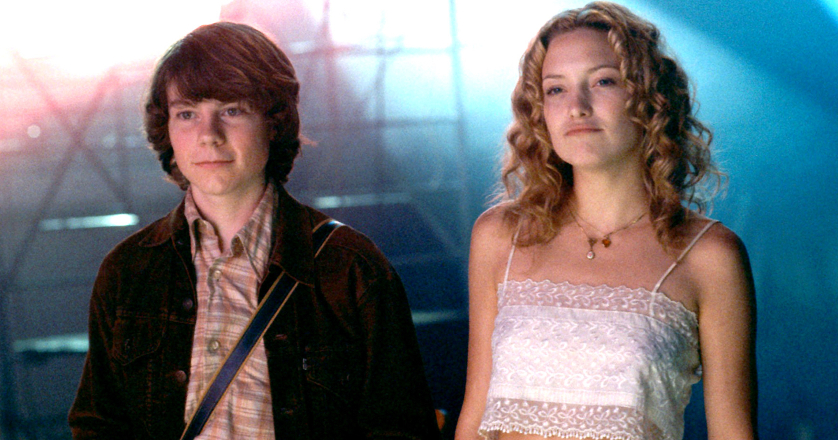 Penny Lane and Will standing next to each other after a show in 'Almost Famous'