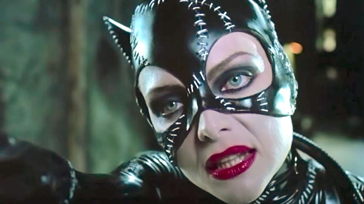 Michelle Pfeifer as Catwoman in Batman Returns wearing a mask with red lipstick