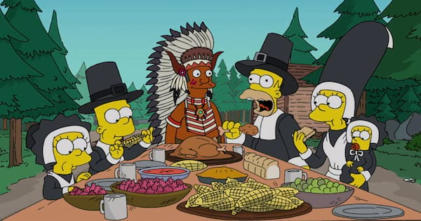 The Simpsons as pilgrims enjoying the first Thanksgiving meal