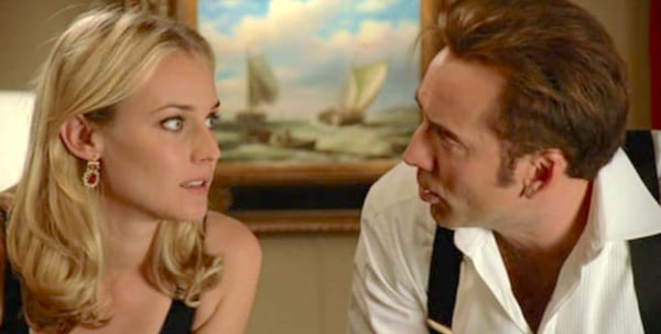 Diane Krueger and Nicolas Cage staring at each other in a scene from National Treasure