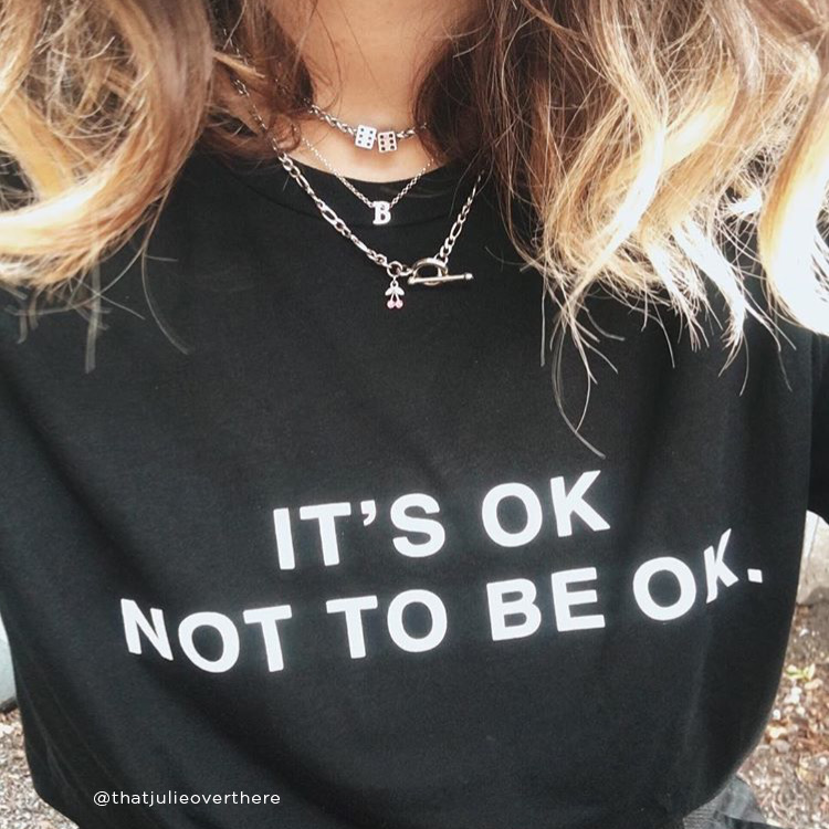 Girl wearing the It's Ok Compass Tee from Hope for the Day