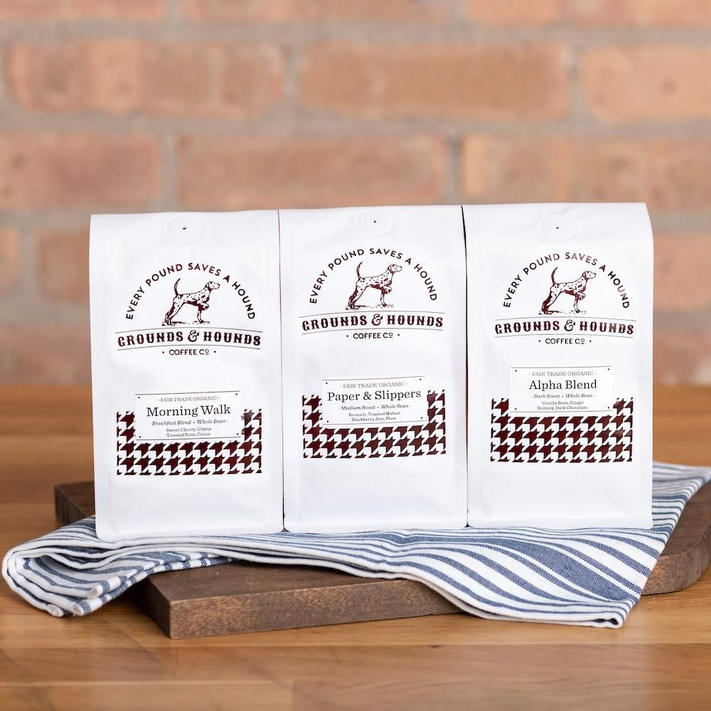 Grounds & Hounds Three Blend Starter Kit sitting on a wood cutting board
