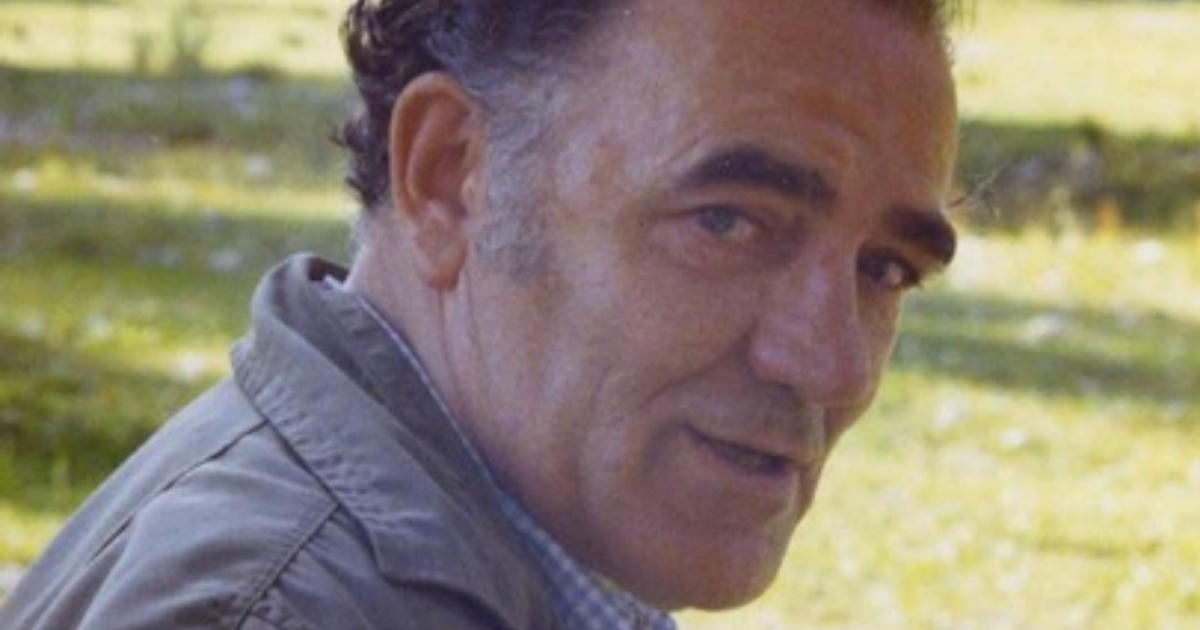 Louis L'amour looking at the camera at a park