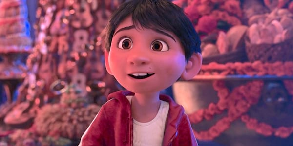 Miguel from \Coco\ transfixed and partially smiling at something or someone