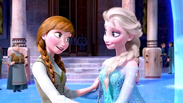 Anna and Elsa from Frozen smiling at each other