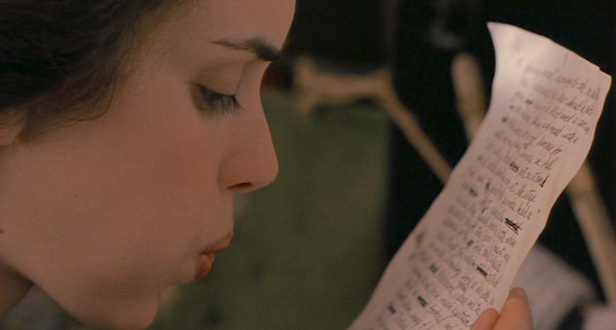 Winona Ryder blowing ink to dry on a piece paper in the 1994 movie, little women