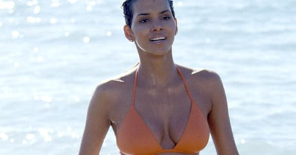 Halle Berry emerging from the water wearing an orange bikini in 'Die Another Day'