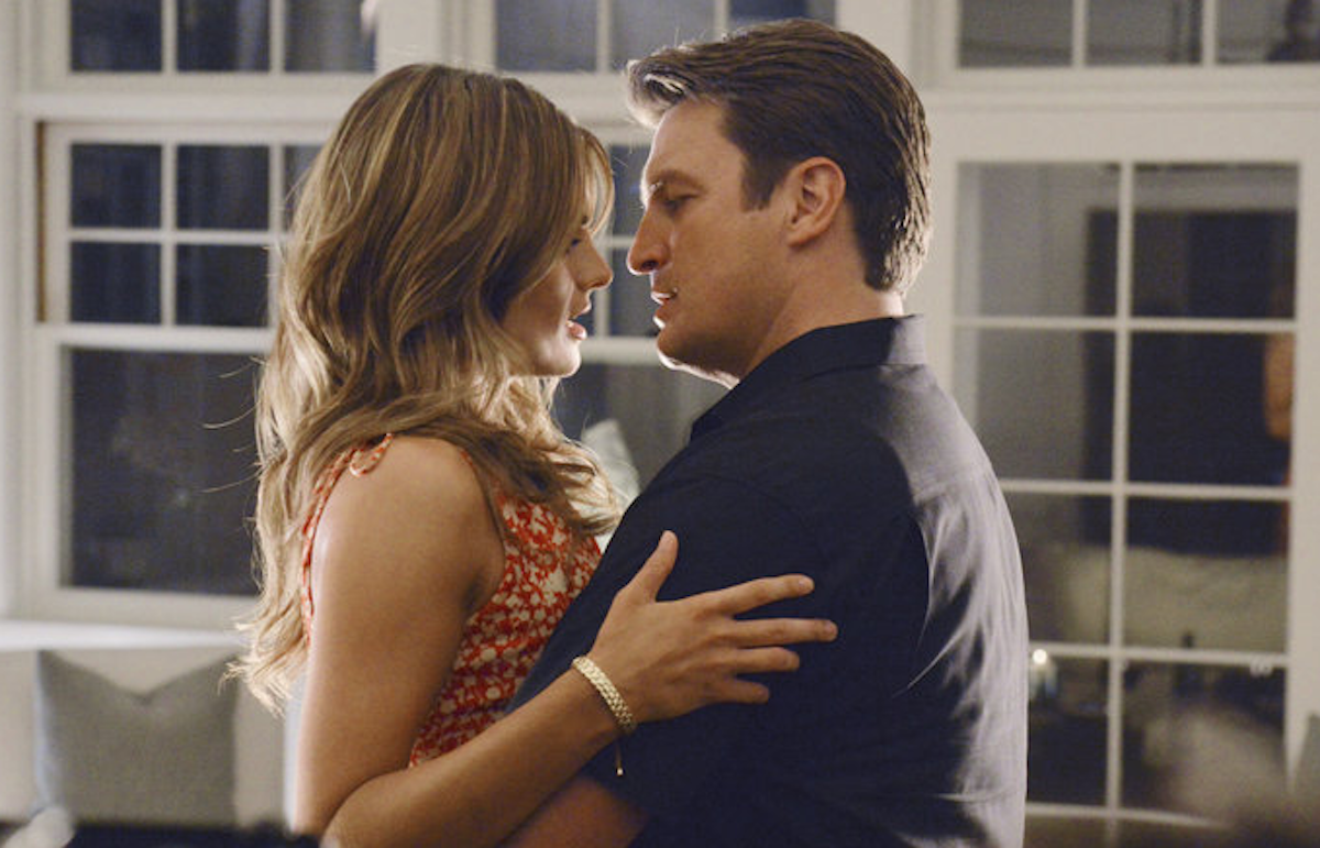 Beckett and Castle holding each other closely from a scene in 'Castle'
