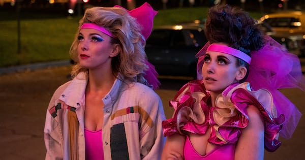 Ruth and Debbie looking at the marque at a Las Vegas hotel in season three of 'Glow'