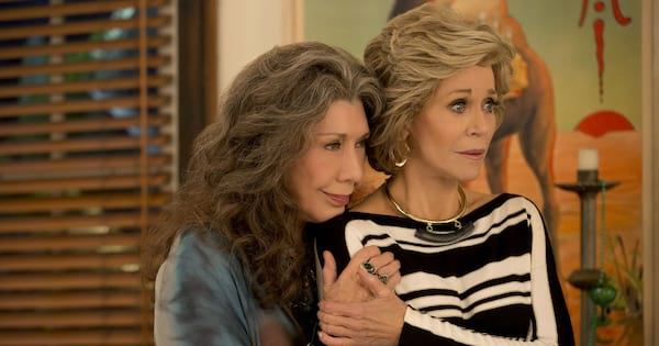 Frankie coddling Grace in a scene from 'Grace and Frankie'