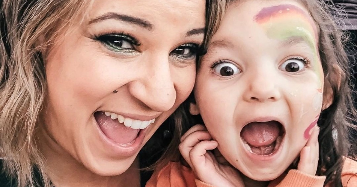 mother and daughter with autism smiling happy