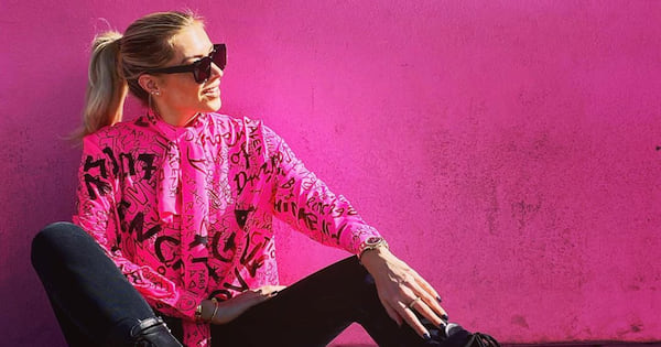 melrose paul smith pink wall woman sitting