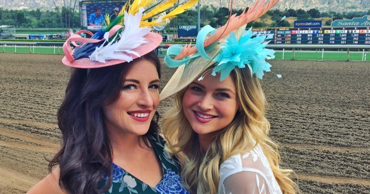 two women smiling wearing hats at kentucky derby churchill downs