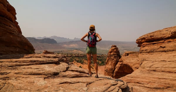 woman hiking in arches national park utah