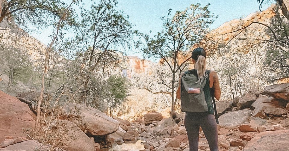 woman hiking in zion national park utah