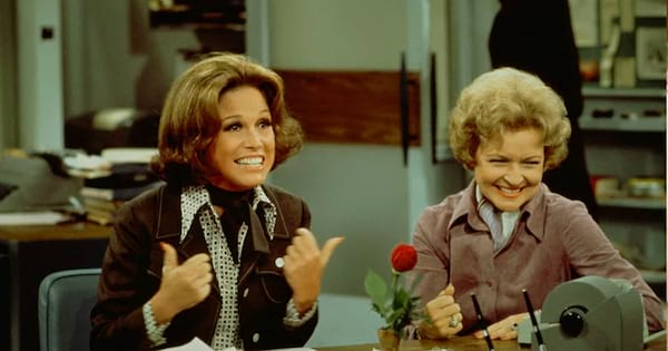 Mary Tyler Moore sitting with her friend making her laugh.