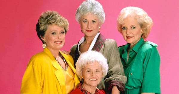 The main cast of The Golden Girls standing together for a photo shoot.