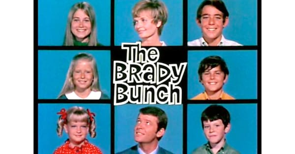 The Brady Bunch logo with all eight members of the Brady family.